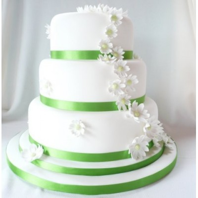 Green and white wedding cake with three tiers and flowers
