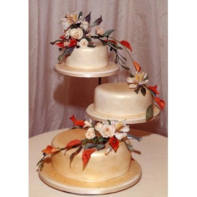 Elegant gold colour three tier wedding cake