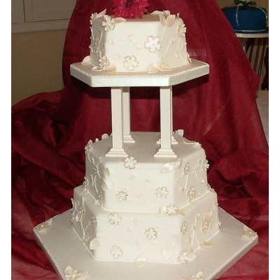 Stunning three tier cake with pillars