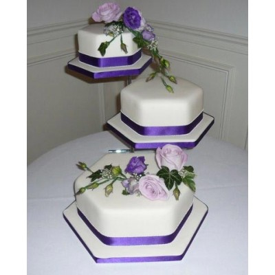 Elegant purple trimmed cake with lilac and purple flowers