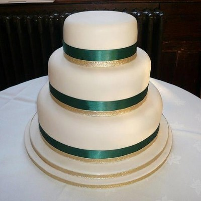 Simple white cake with green and gold trimming