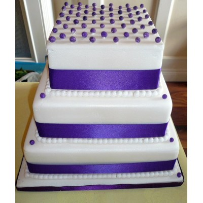 Purple three tier ribboned cake with dotted design