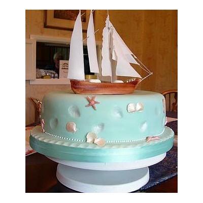 Sailing ship theme wedding cake with sea images