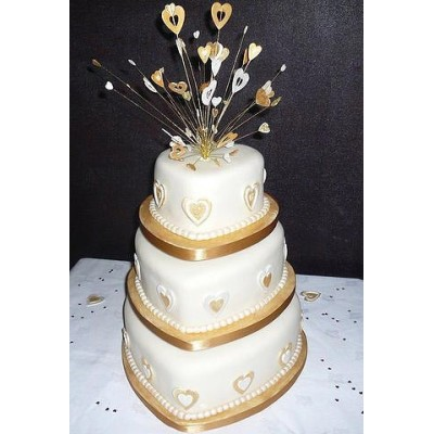 Three tier wedding cake with gold trim and crystal topper