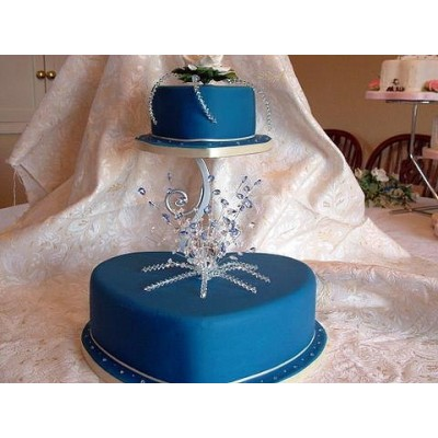 Bold blue colour wedding cake with blue crystal toppers