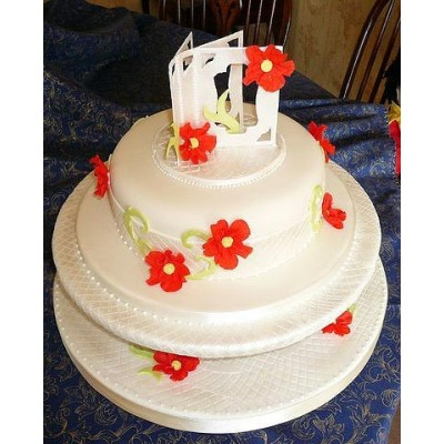 Multi tier cake with red flowers and topper