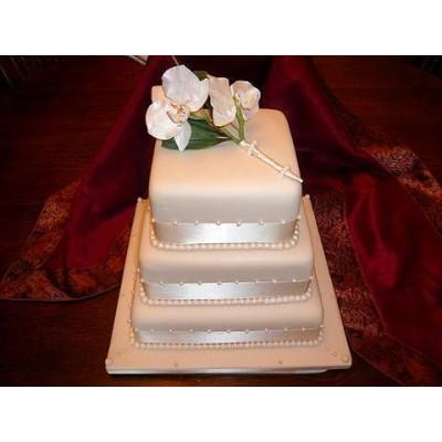 Square three tier cake with elegant flower design