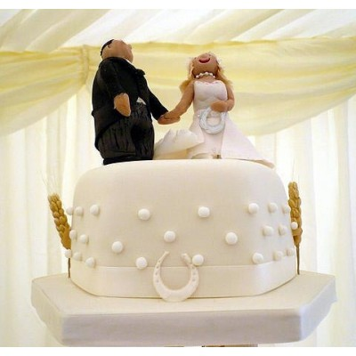 Dotted wedding cake with bride and groom characters