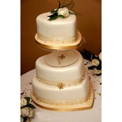 Three tier cake with gold trim