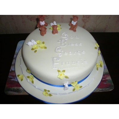 Round white cake with Bear and Rabbit figurines