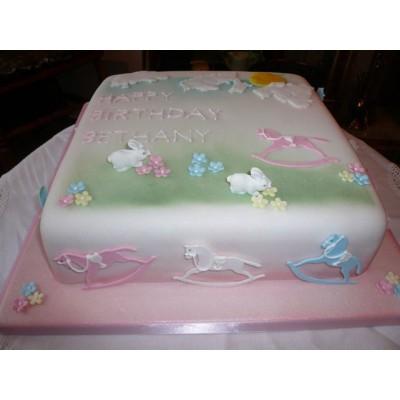 Custom Christening cake with rocking horses