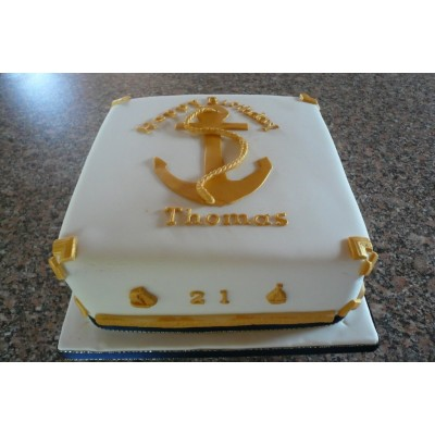 White and gold cake with anchor design