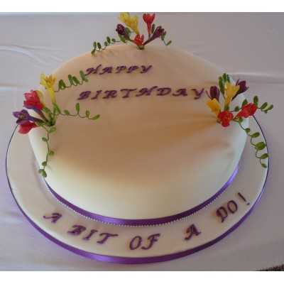 Elegant Purple trimmed birthday cake with flowers