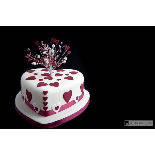 Heart Shaped Wedding Cake With Crystal Topper