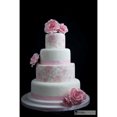 Four Tier Wedding Cake With Pink Flower