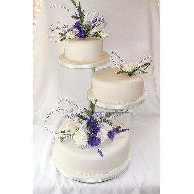 White 3 tier wedding cake with Blue and White Flowers