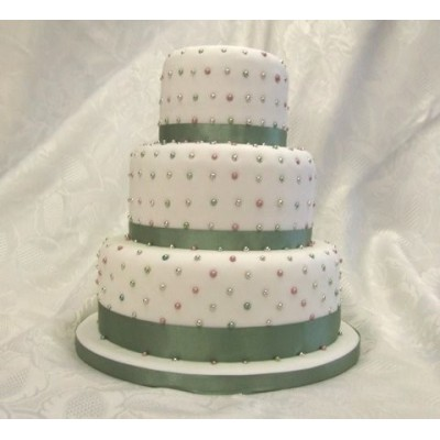 Small oval 3 tier sponge cake.