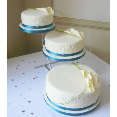 Elegant Wedding Cake with Three Tiers and Blue Ribbon