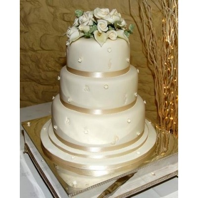 3 tier cake with hand made sugar roses and cala lillies with beading.