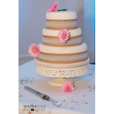 3 tier sponge cake with Hessian ribbon and fresh flowers