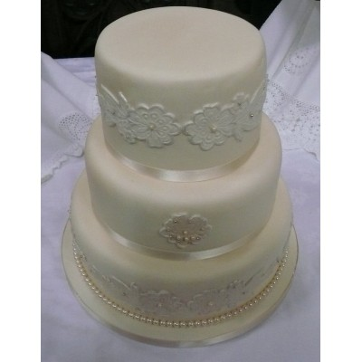 3 tier cake with moulded lace detail pearl trim
