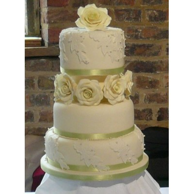 3 tier cake with moulded lace detail finished with roses