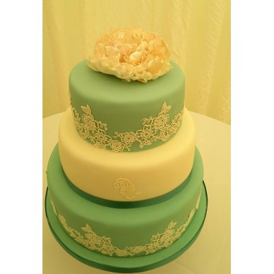 3 tier light teal and ivory cake