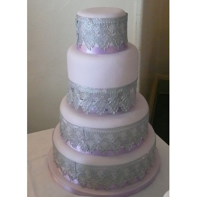 4 tier cake covered with silver icing lace