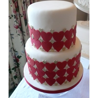 2 tier deep cake covered with hearts