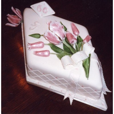 Diamond shaped cake with flower and ribbon decoration