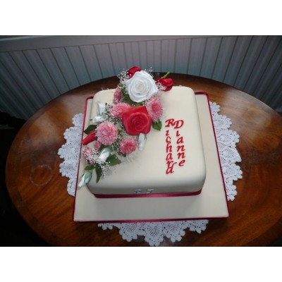 Square Cake With Red Ribbon And Elaborate Flowers And