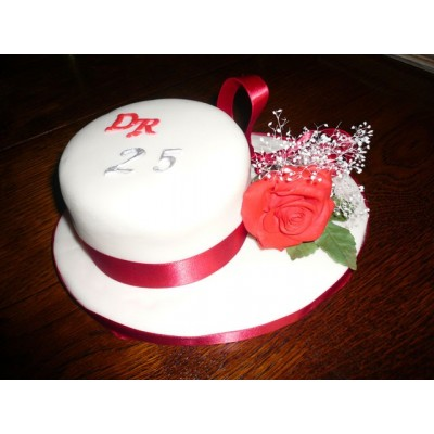 Small Circular cake with Red Ribbon and Flower decoration