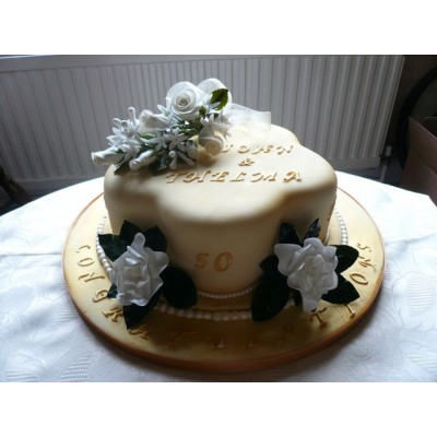 Gold anniversary cake with White flowers