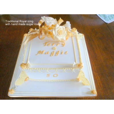 Gold and White anniversary cake with hand made sugar roses