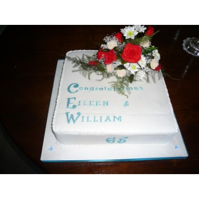 Light Blue on White Cake with Flower topping