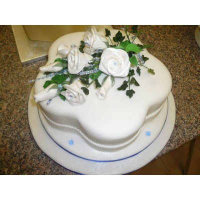 Elegant Blue and white Anniversary cake with Flowers