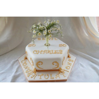 Decorative Gold Leaf Coloured Detailing on Cake with Flower Topper