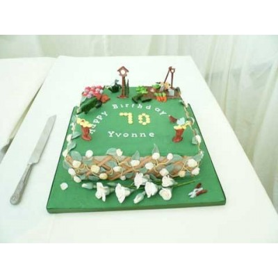 Garden scene cake with flowers and vegetables ...