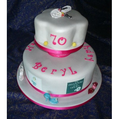 Two tier Birthday Cake with Pink detailing